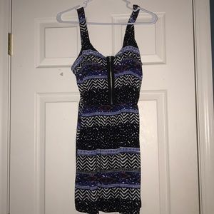 Summer slip on dress with a fake zipper on front.